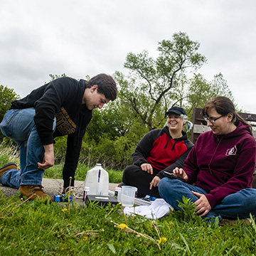 Green Iowa AmeriCorps members work on a water quality project.