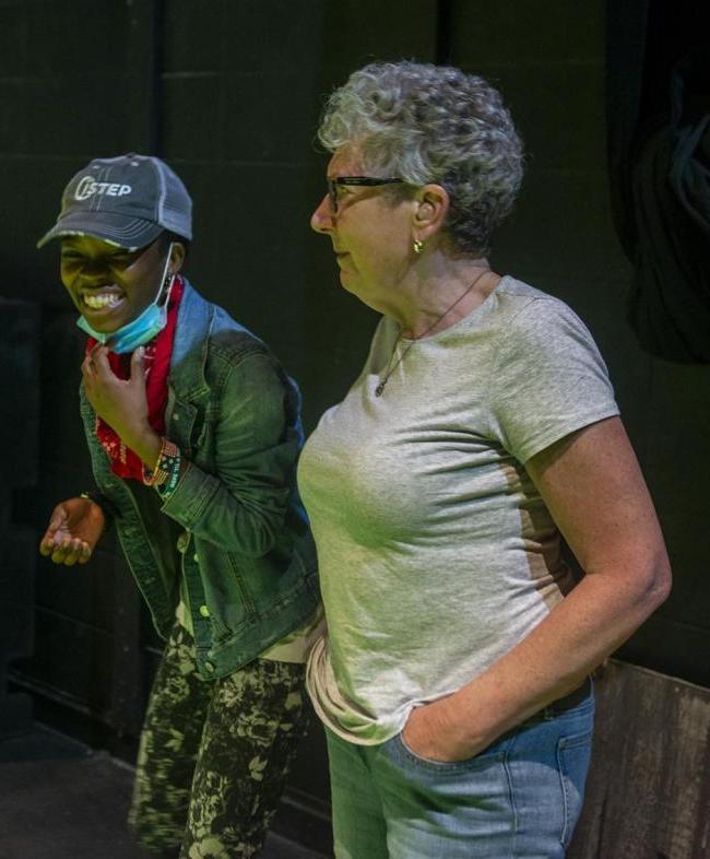 UNI theatre professor Gretta Berghammer talks with a high school student during a theatre workshop at UNI.