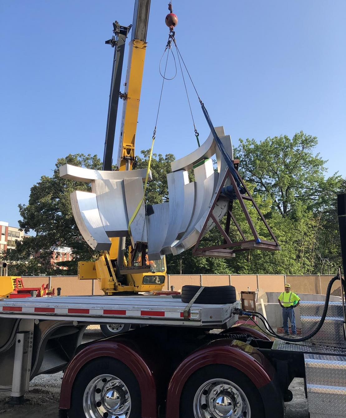 A sculpture built in the University of Northern Iowa's Public Art Incubator arrives at Iowa City.