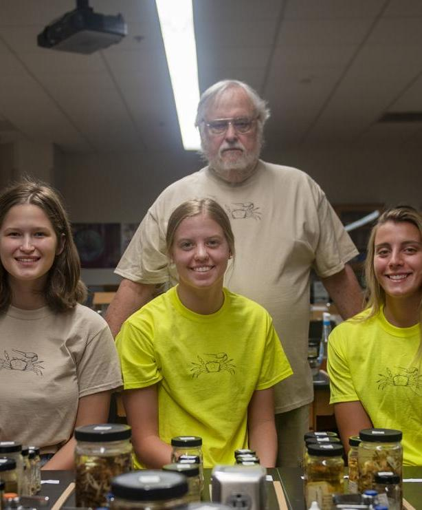Team Crab: biology professor Carl Thurman (standing) and, from left to right, senior biology major Dee Dee Pitzen and sophomore