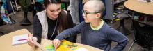 UNI students instruct elementary students in literacy.