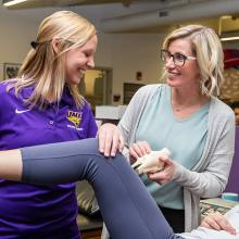 UNI graduate student Paige Mathews works in the athletic training area in the Human Performance Center.