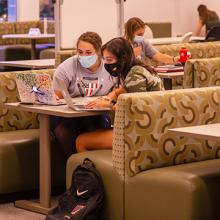 UNI students wear masks while studying in the Rod Library.