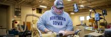 UNI student Caleb Christine works in the Industrial Technology Center.
