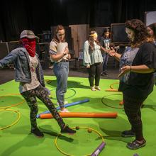 Students participate in a theatre workshop at UNI.
