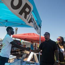 UNI alum DaQuan Campbell interacts with a customers at the Waterloo Urban Farmers Market.