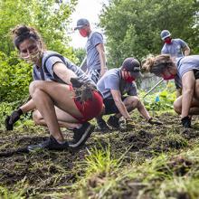 UNI AmeriCorps members install a residential garden in Cedar Falls.