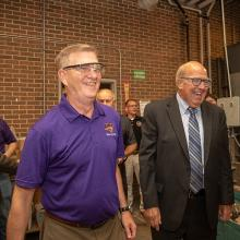 UNI President Mark A. Nook and Iowa state legislator Gary Mohr tour UNI's ITC.