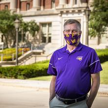 UNI President Mark A. Nook wears a mask on campus.