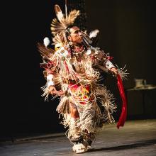 Larry Yazzie, a renowned Meskwaki fancy dancer, in the Strayer-Wood Theatre.