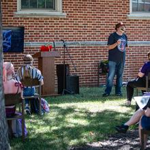 UNI languages and literature professor Grant Tracey teaches a class outside.