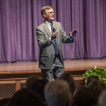 UNI President Mark A. Nook addresses faculty and staff about the university's recruitment strategy.