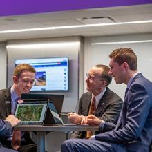 UNI professor Arthur Cox teaches real estate students Andrew Hubbard, Matthew Perk, Jared Larson in the classroom.