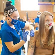 Senior elementary education major Marisa Jane gets a COVID-19 vaccine.