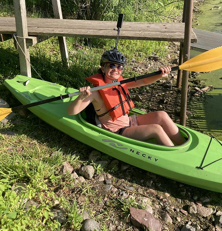 UNI senior Lindsey Hubbell in a kayak.