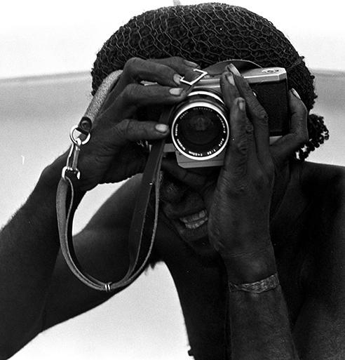 Indigenous individual with a camera