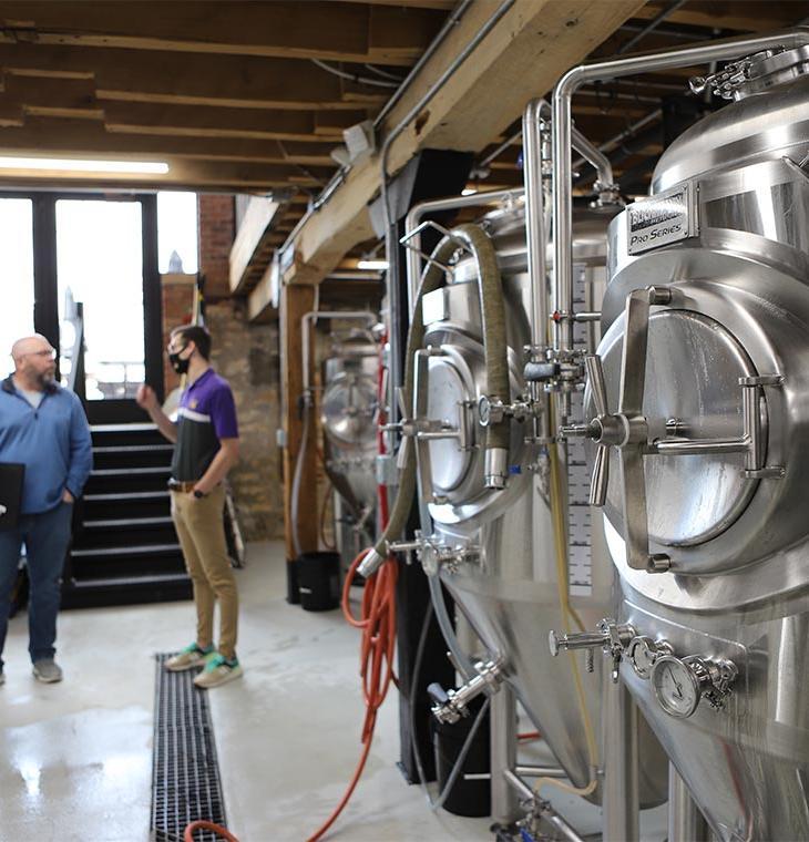 IWRC staff working with brewery